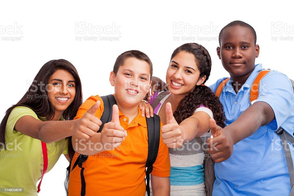 Multi-ethnic teenagers making thumbs up stock photo