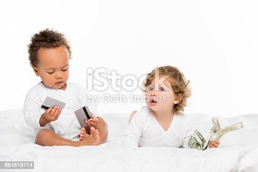 istock multiethnic toddlers with money 884819114