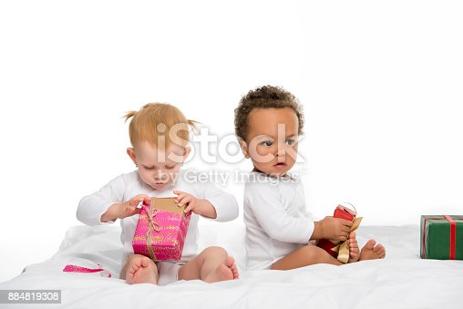 istock multiethnic toddlers with wrapped gifts 884819308