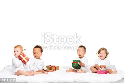 istock multiethnic toddlers with wrapped gifts 884819416