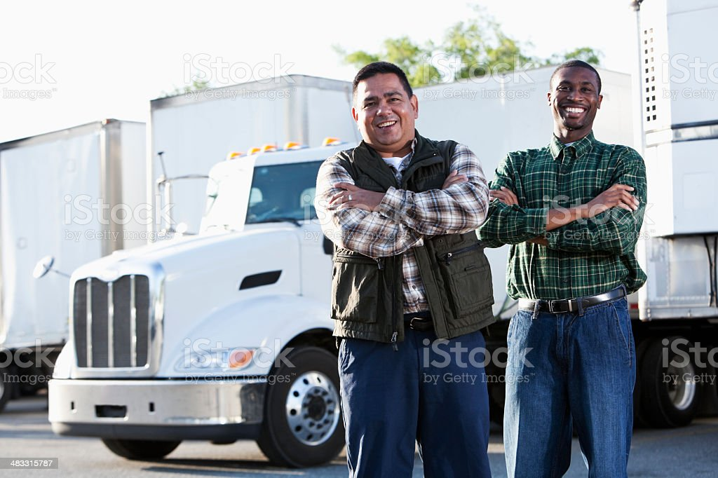 Multi-ethnic truck drivers stock photo