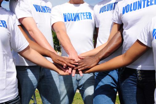 Multiethnic Volunteer Group Hands Together Stock Photo - Download Image Now
