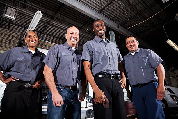 multi-ethnic workers at trucking facility - uniform stock photos and pictures