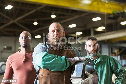 istock Multi-ethnic workers in metal fabrication plant 856743896