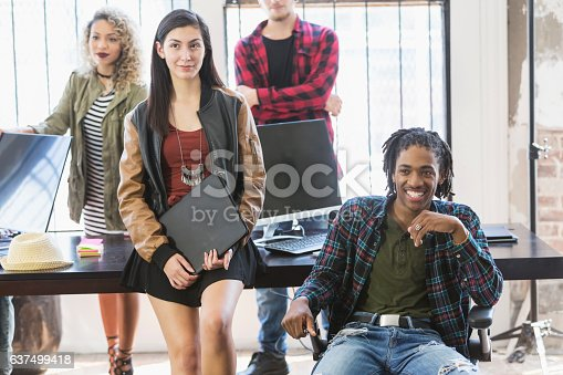 istock Multi-ethnic young creatives in a business meeting 637499418