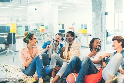 istock Multi-ethnic Young People Celebrating Movember In Their Office. 490370322
