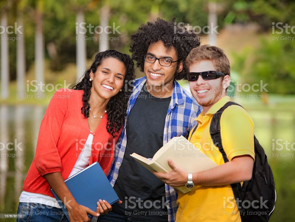 Multi-ethnics group of young students at the university campus stock photo
