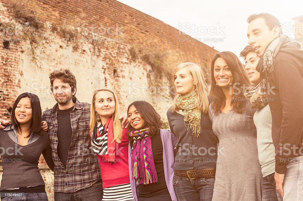 Multiethnics people embracing togetherness royalty-free stock photo