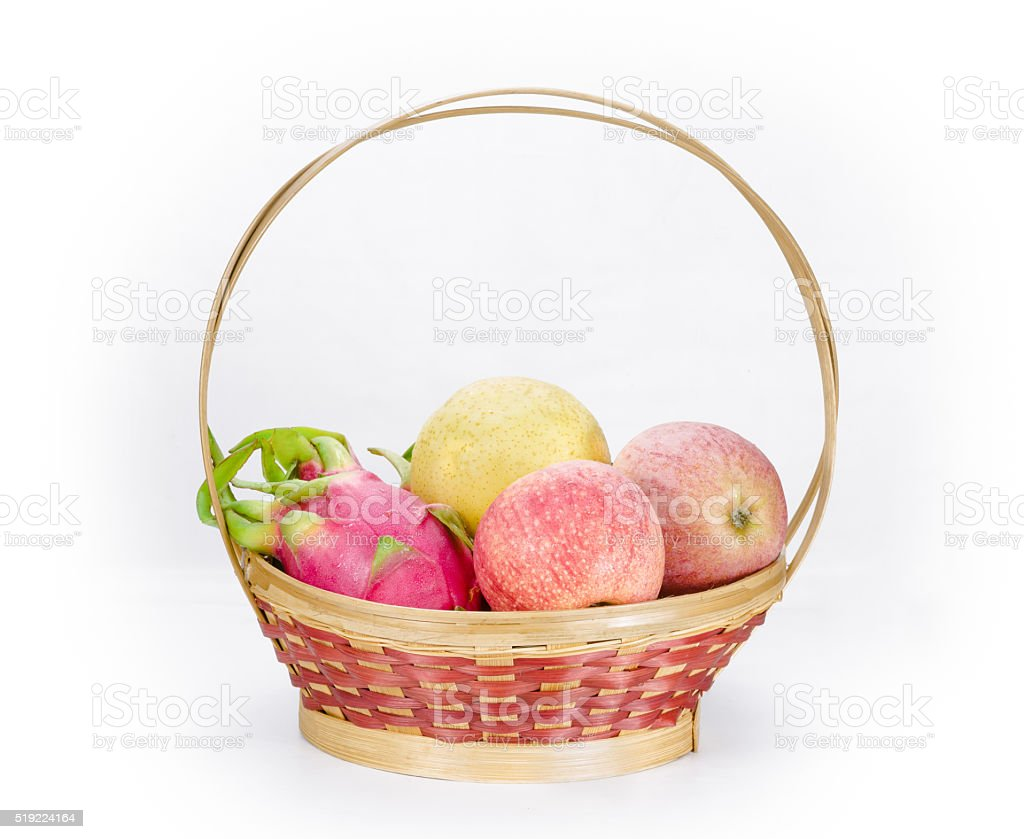 multi-fruits in basket on white background stock photo