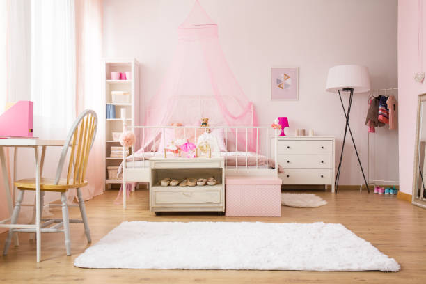 Multifunctional girl room with bed Multifunctional girl room with bed, rug, chair and desk girl bedroom stock pictures, royalty-free photos & images