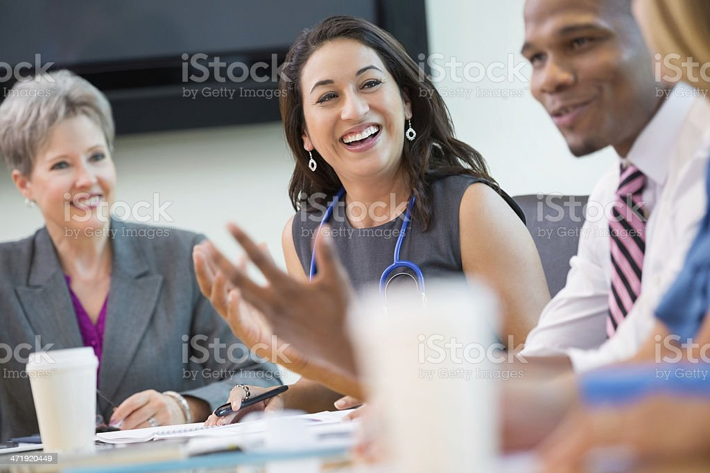Multi-gender business meeting stock photo