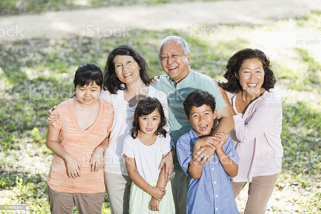 Multi-generation Asian family with autistic daughter stock photo