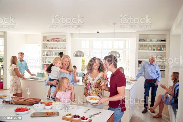 Multigeneration family and friends gathering in kitchen for party picture id1048317078?b=1&k=6&m=1048317078&s=612x612&h=c6toslrcoe9lxjyedpduaaijmabcyrz mxnpf p oxc=