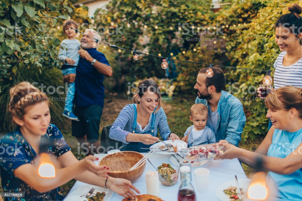 Multi-generation family at a dinner party stock photo