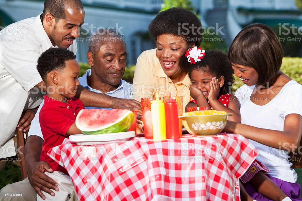 Multi-generation family at picnic table stock photo