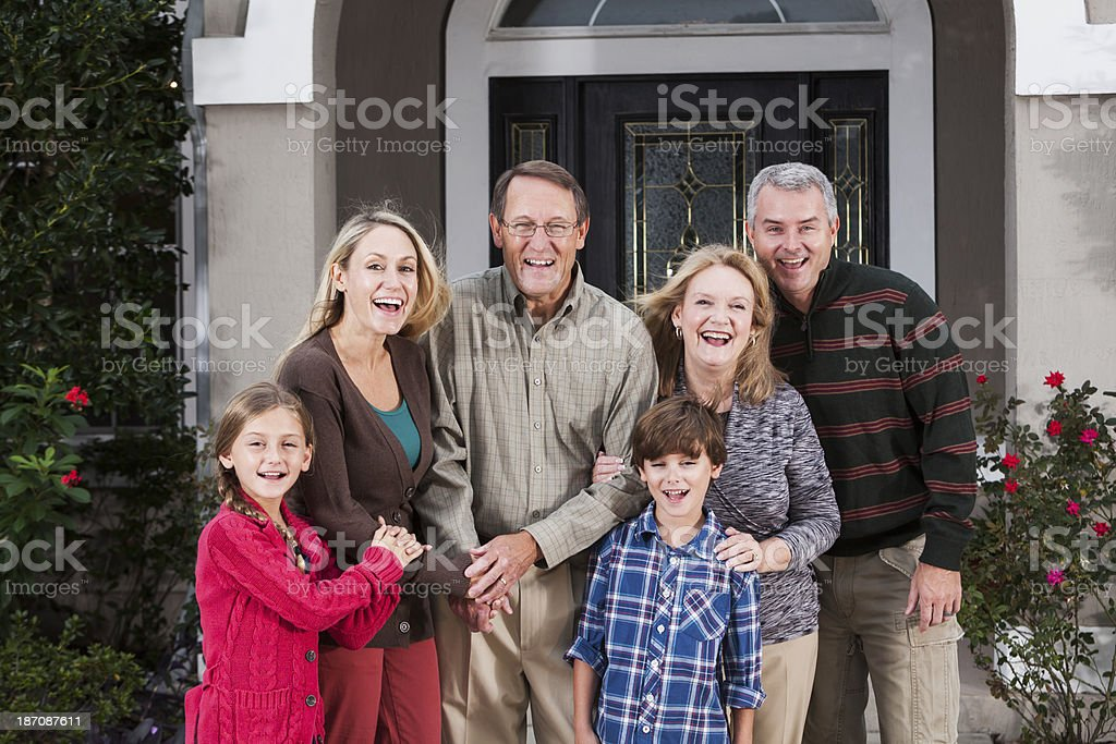 Multi-generation family, children, parents, grandparents in front of house royalty-free stock photo