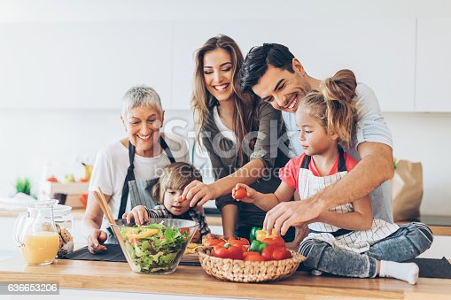 istock Multi-generation family cooking 636653206