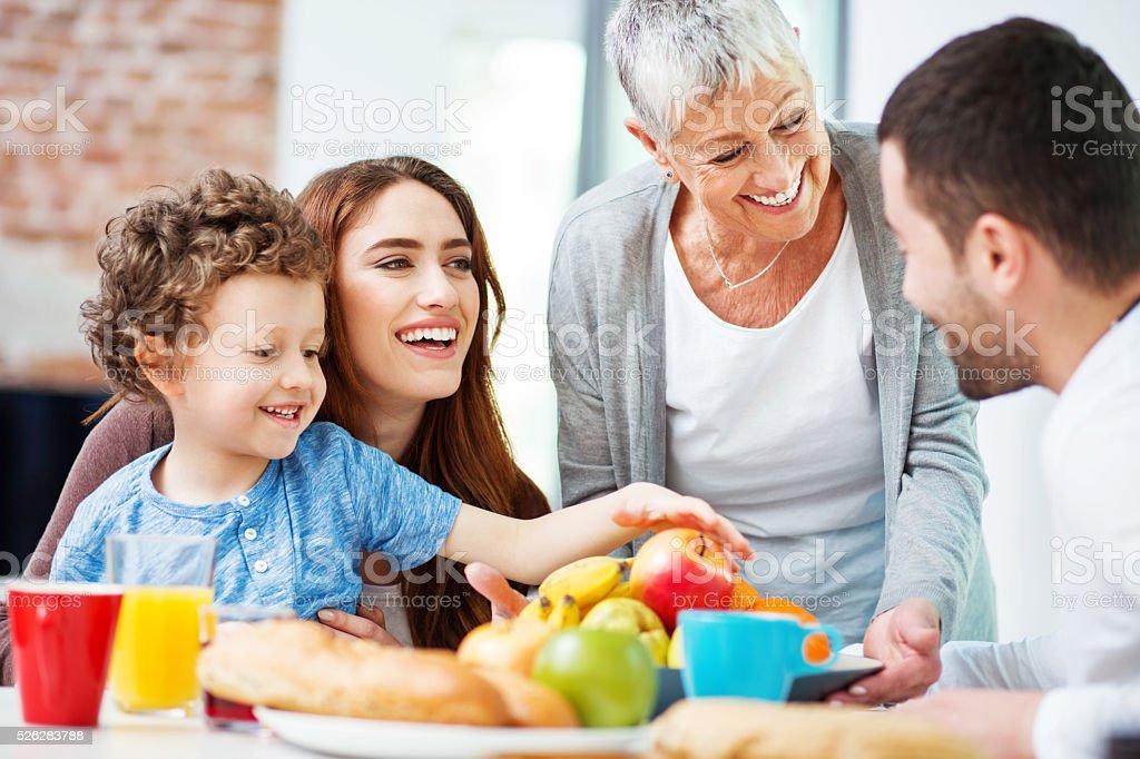 Multi-generation family eating fruits stock photo