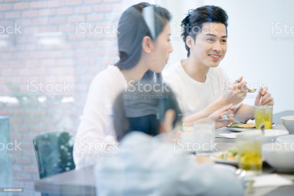 Multi-generation family eating in the kitchen stock photo