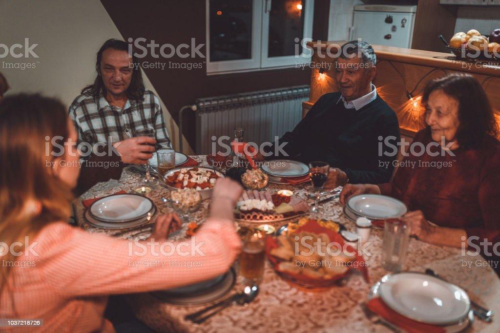 Multi-generation family enjoying holiday dinner at home