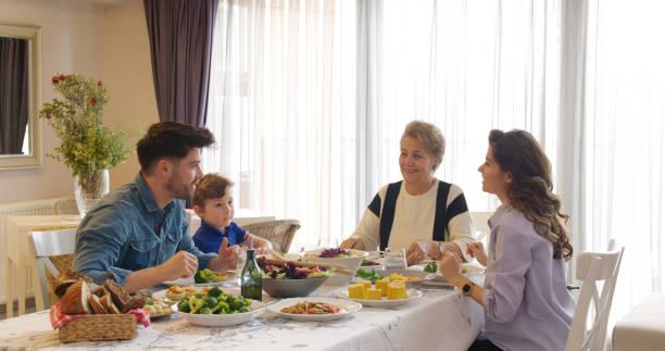 Multi-generation family having a vegan dinner stock photo