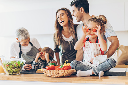 638984280 istock photo Multi-generation family having fun in the kitchen 635754656