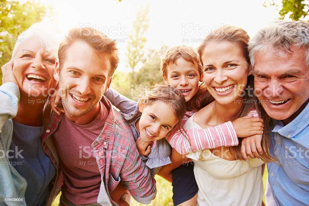 Multi-generation family having fun together outdoors stock photo