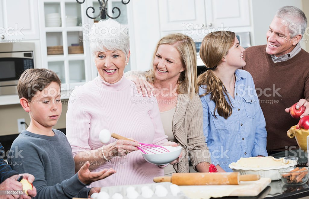 Multi-generation family in the kitchen stock photo