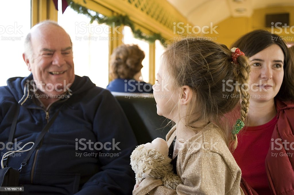 Multi-generation family on a train ride royalty-free stock photo