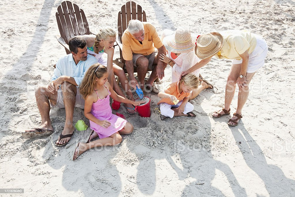 Multi-generation family on beach stock photo