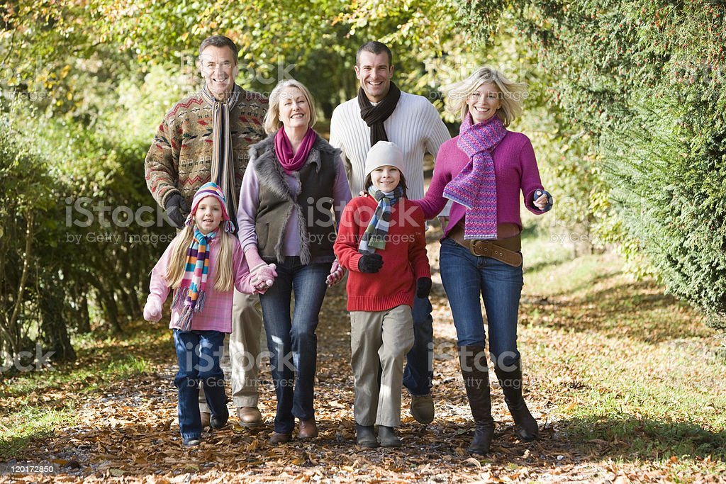 Multi-generation family on walk through woods royalty-free stock photo