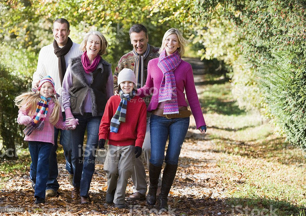 Multi-generation family walking through woods royalty-free stock photo