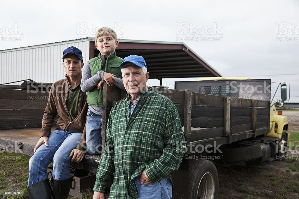 Multi-generation family working on the farm stock photo