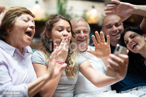 istock Multi-Generation hispanic-latino family having a video chat at home 1092664966