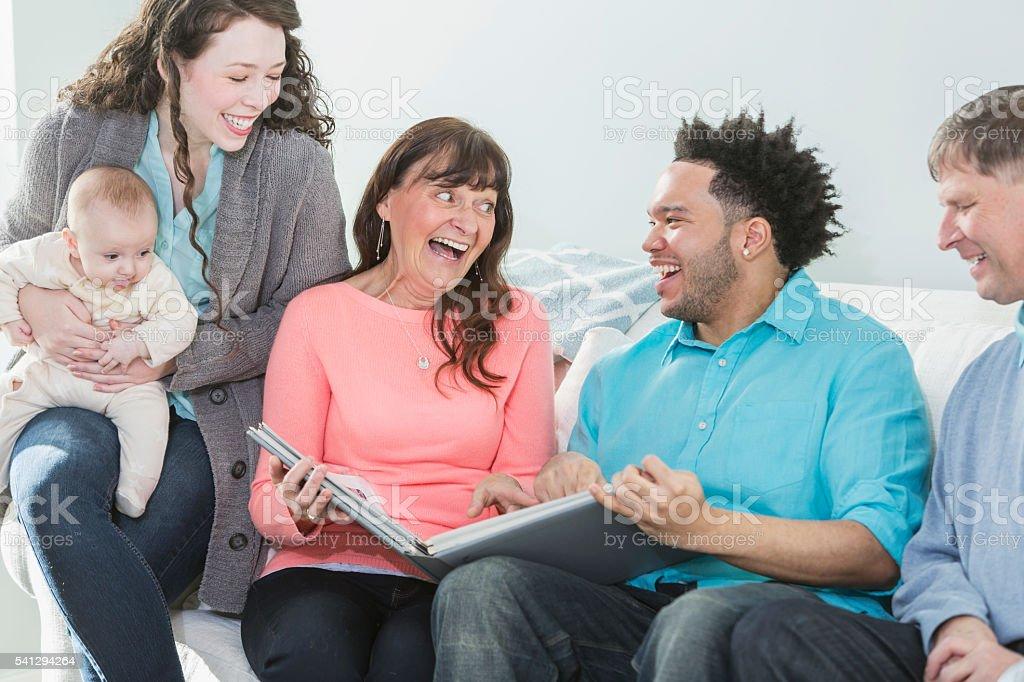 Multi-generation, multi-ethnic family, photo album stock photo