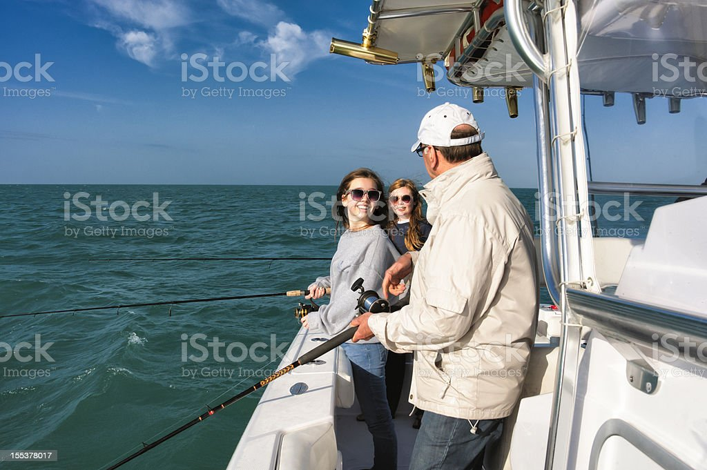 Multi-generation real family fishing on a boat. stock photo