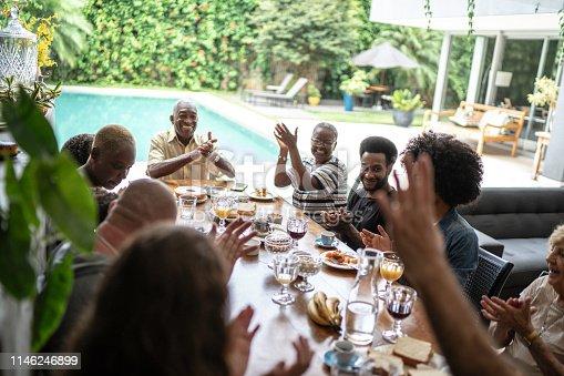 istock Multigenerational family applauding during breakfast 1146246899