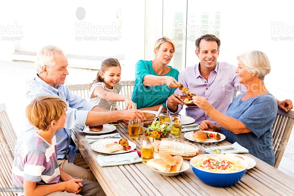 Multi-Generational Family Having Meal Together Al Fresco stock photo