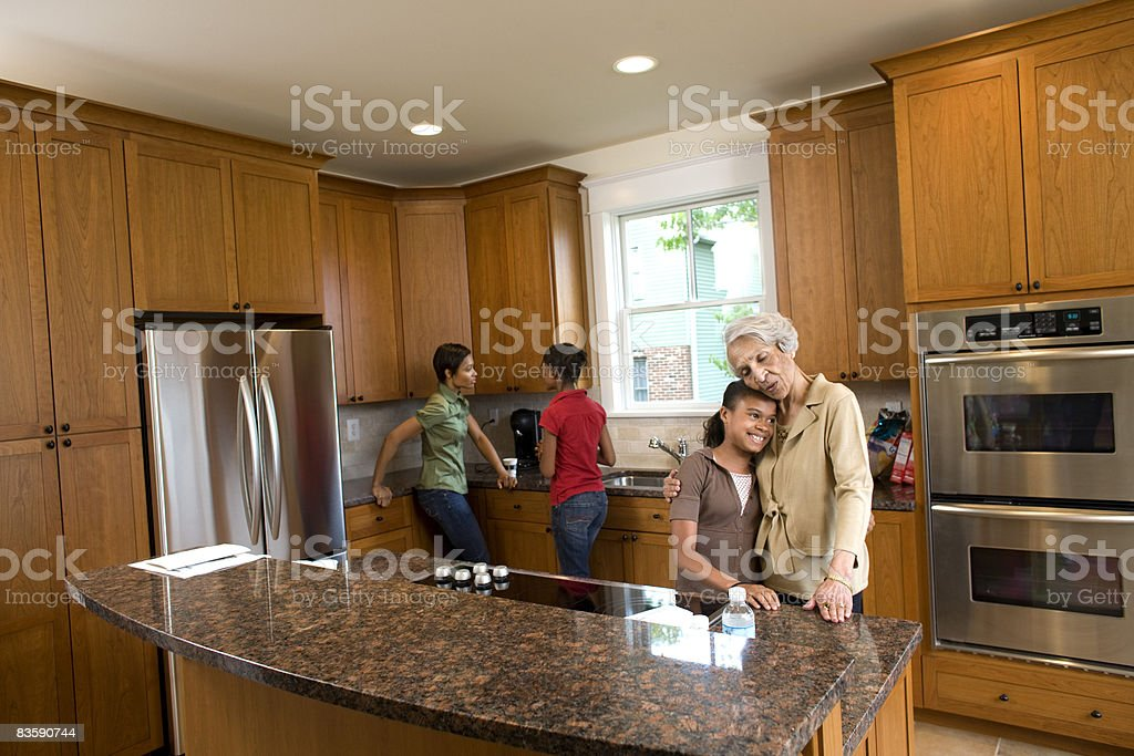 Multigenerational family in kitchen of new home royalty free stockfoto