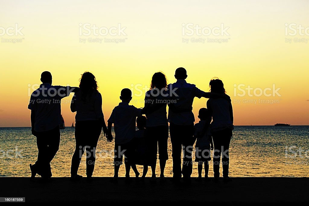 Multi-generational family watching the sunset royalty-free stock photo
