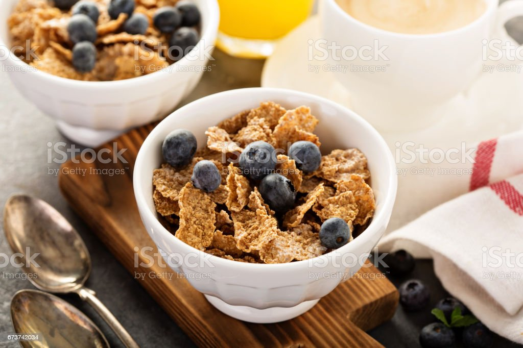 Multigrain healthy cereals with fresh blueberry stock photo