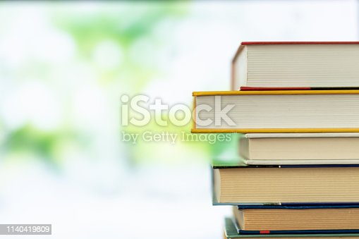 Book stack in the library room and blurred trees on street back to school concept for business and education background, back to school concept