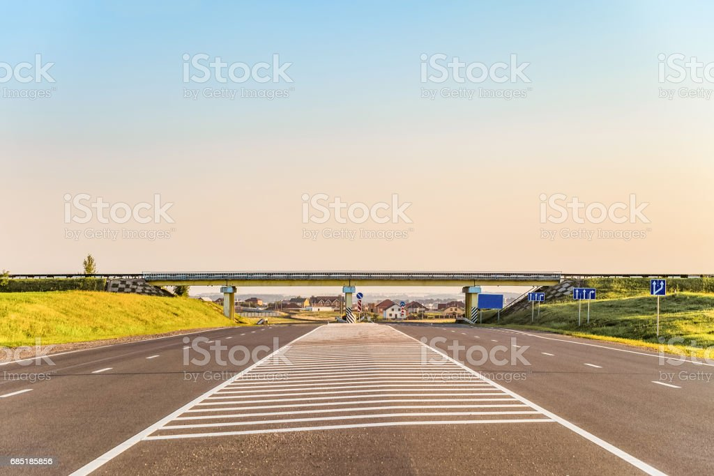 Multi-lane countryside asphalt road with marking. Intersection of the country roads on two levels. Disappearing into the distance perspective. Belgorod region, Russia. stock photo