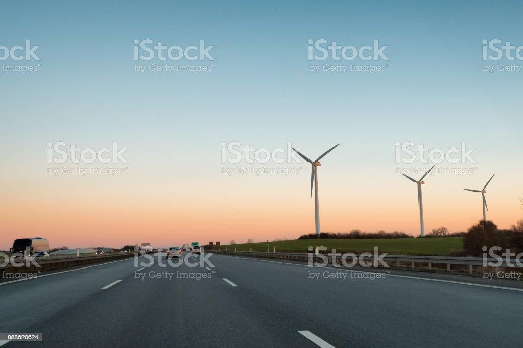 Multi-lane expressway at sunset. stock photo