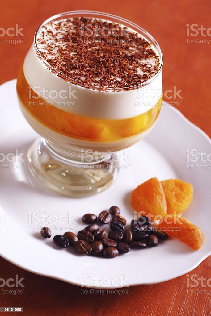 Multilayer gelatin dessert with chocolate, cream and jelly in glass royalty-free stock photo