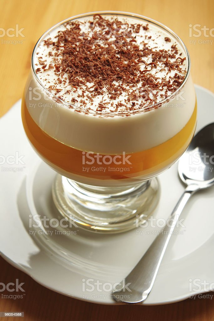 Multilayered gelatin dessert with chocolate, cream and jelly in glass royalty-free stock photo