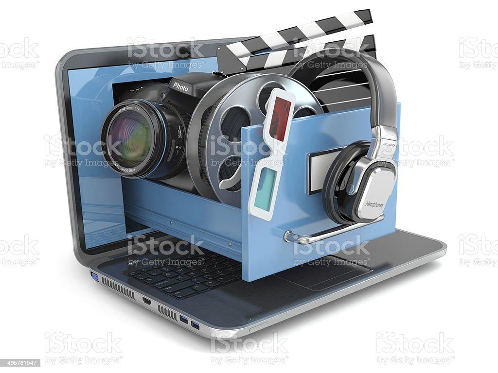 Multimedia concept. Laptop, camera , headphones and video attrib stock photo