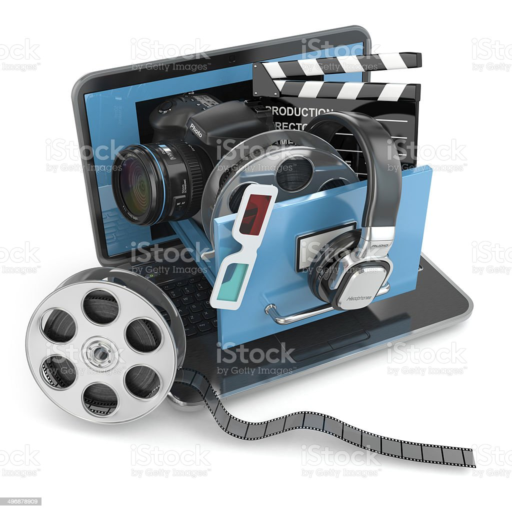 Multimedia concept. Laptop, camera , headphones and video attrib stock photo