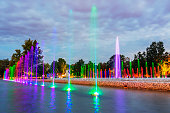 istock Multimedia fountain park during twilight, Warsaw, Poland - A colorful Fountain situated in the city center 1036155082