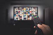 istock Multimedia video concept on TV set in dark room 1159486774